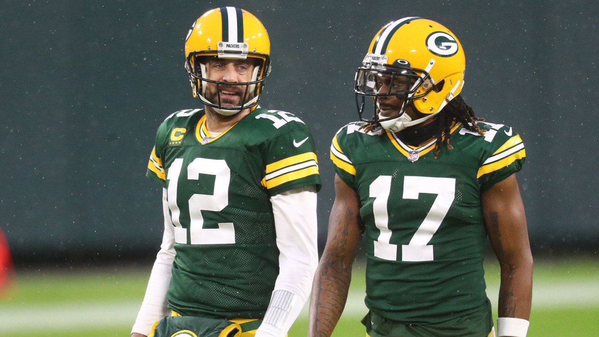 Aaron Rodgers and Davante Adams talk as they walk off the field during a 2020 game