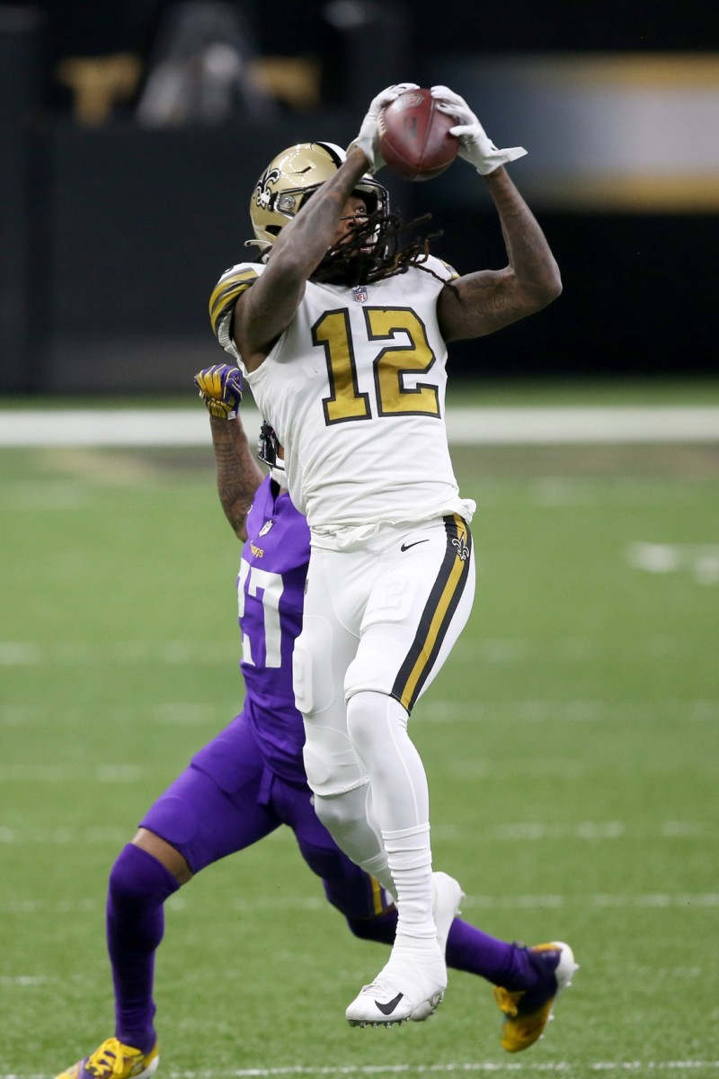 Marquez Callaway Leaps to Catch Football Over Vikings Defender