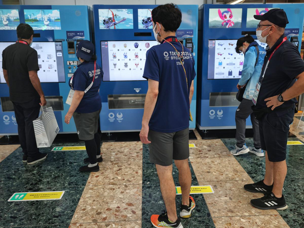 People wander outside of Tokyo Olympics vending machine