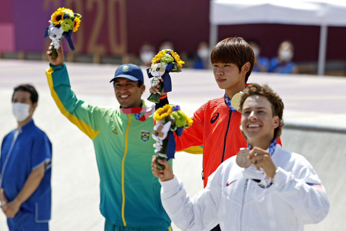 Brazil's Kelvin Hoefler with gold medalist Yuto Horigome of Japan and silver medalist Jagger Eaton of the U.S.