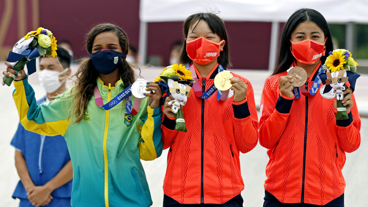 Rayssa Leal (BRA), silver; Momiji Nishiya (JPN), gold; and Funa Nakayama (JPN), bronze; celebrate with their medals in the women's street skateboard during the Tokyo 2020 Olympic Summer Games.