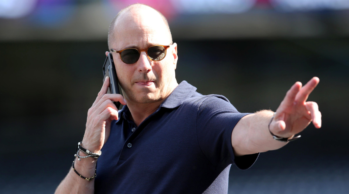 Oct 2, 2019; New York, NY, USA; New York Yankees general manger Brian Cashman gestures while on the phone during a workout day before game 1 of the ALDS at Yankees Stadium.