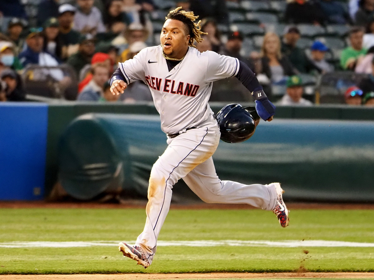 Jul 16, 2021; Oakland, California, USA; Cleveland Indians third baseman Jose Ramirez (11) runs home to score a run against the Oakland Athletics during the sixth inning at RingCentral Coliseum.