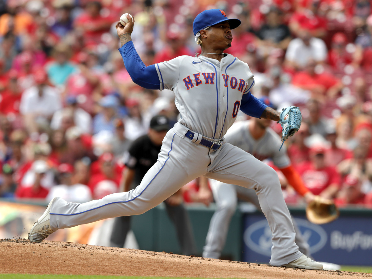 Jul 21, 2021; Cincinnati, Ohio, USA; New York Mets starting pitcher Marcus Stroman (0) throws a pitch against the Cincinnati Reds in the first inning at Great American Ball Park.