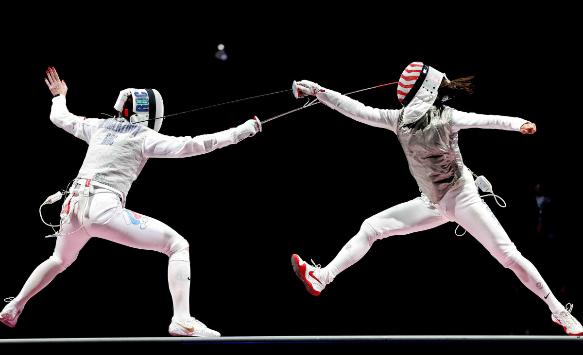 Kiefer (right) defeated Russia'sInna Derglazova on July 25 and became the first American ever to capture gold in individual foil.