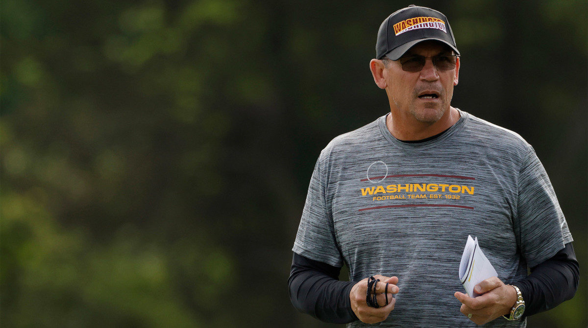 Jun 10, 2021; Ashburn, VA, USA; Washington Football Team head coach Ron Rivera stands on the field during drills as part of minicamp at Inova Sports Performance Center.