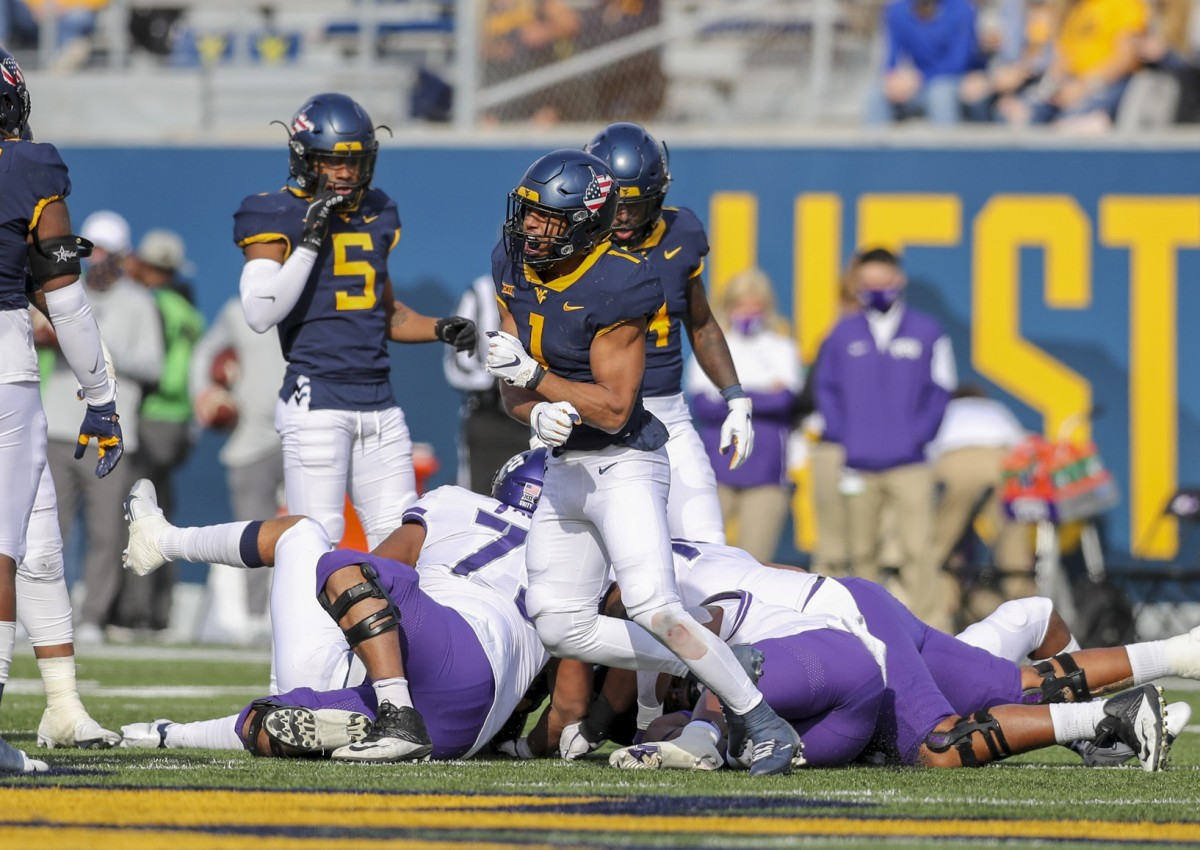 Nov 14, 2020; Morgantown, West Virginia, USA; West Virginia Mountaineers linebacker Tony Fields II (1) celebrates after a defensive stop during the second quarter against the TCU Horned Frogs at Mountaineer Field at Milan Puskar Stadium.