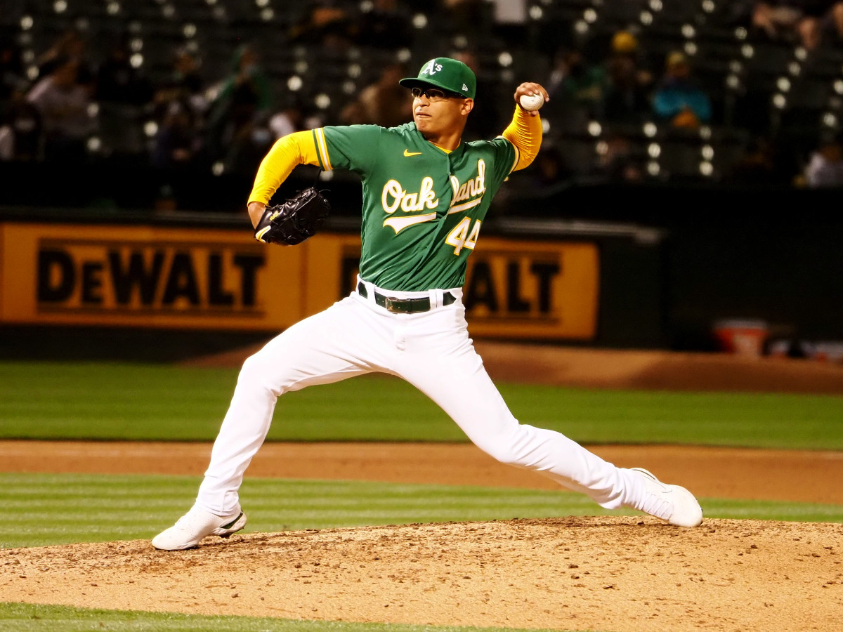 Jun 10, 2021; Oakland, California, USA; Oakland Athletics relief pitcher Jesus Luzardo (44) pitches the ball against the Kansas City Royals during the eighth inning at RingCentral Coliseum.