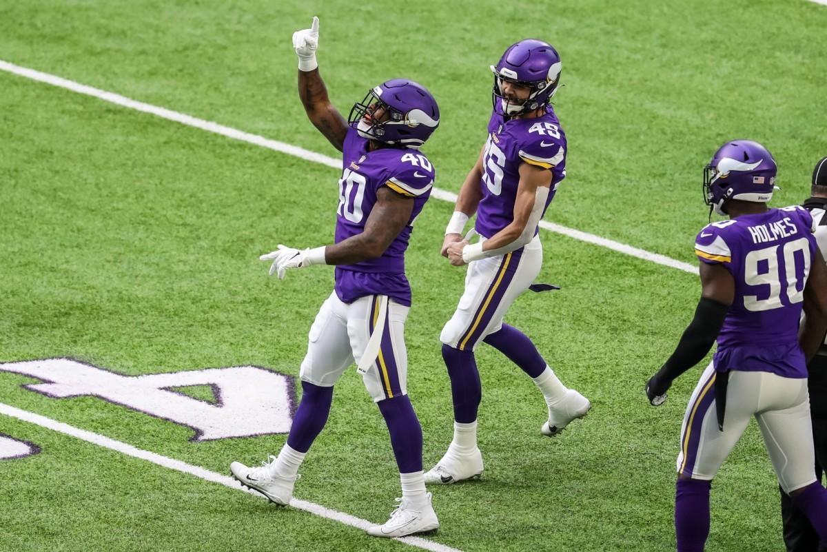 Dec 20, 2020; Minneapolis, Minnesota, USA; Minnesota Vikings linebacker Todd Davis (40) celebrates his sack with linebacker Troy Dye (45) during the first quarter against the Chicago Bears at U.S. Bank Stadium.