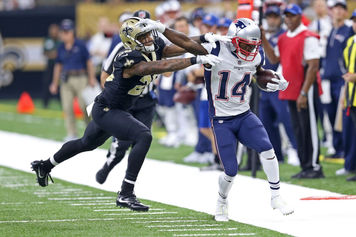 New Orleans cornerback P.J. Williams (26) knocks Patriots receiver Brandin Cooks (14) out of bounds after a catch. Mandatory Credit: Chuck Cook-USA TODAY Sports