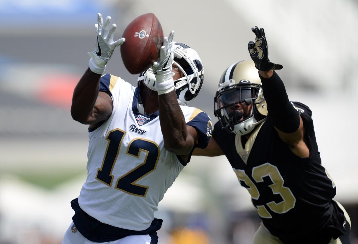 Rams receiver Brandin Cooks (12) catches a pass against Saints cornerback Marshon Lattimore (23). Mandatory Credit: Gary A. Vasquez-USA TODAY