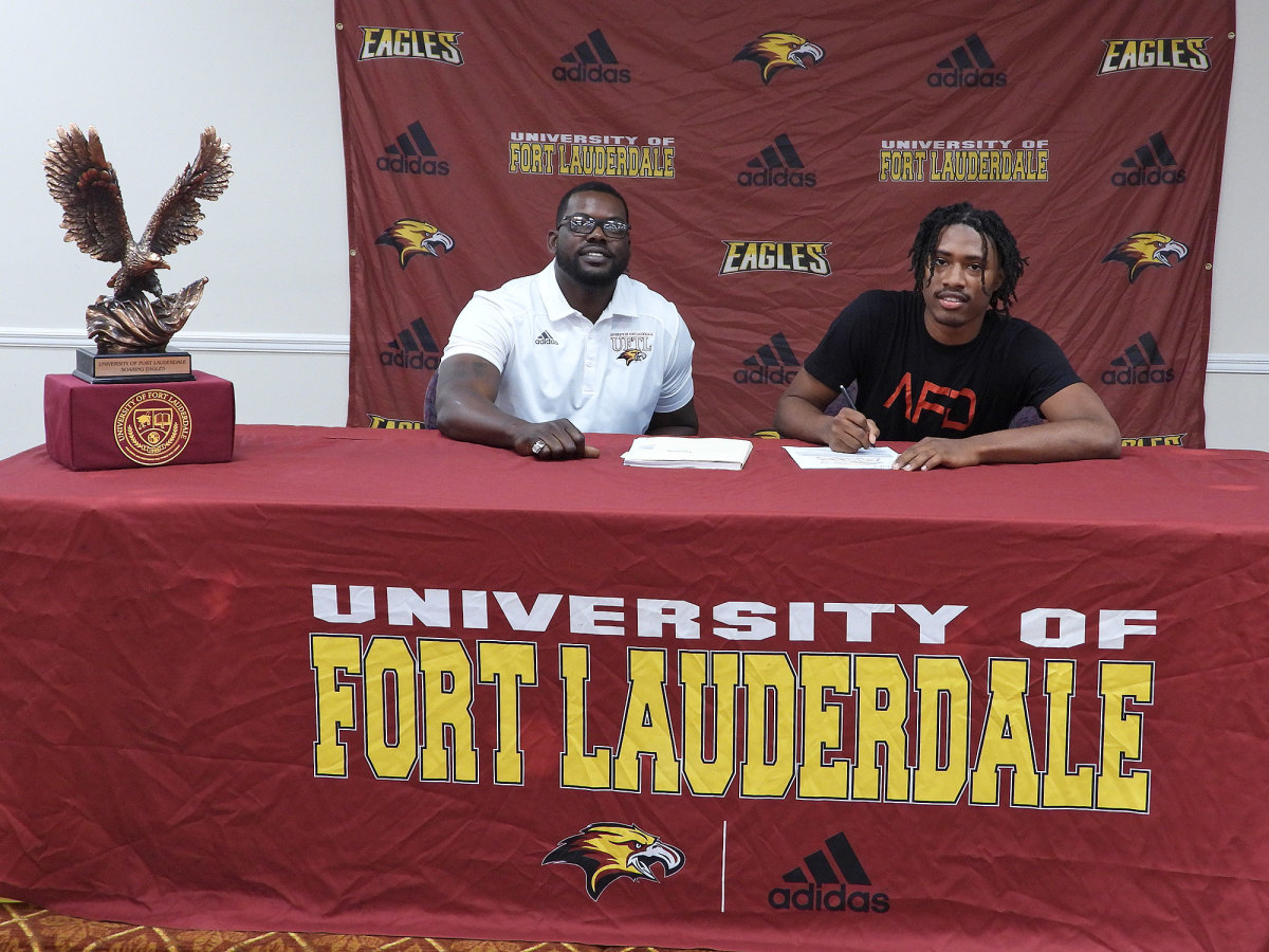 Fort Lauderdale coach Chris Chambers with a signee
