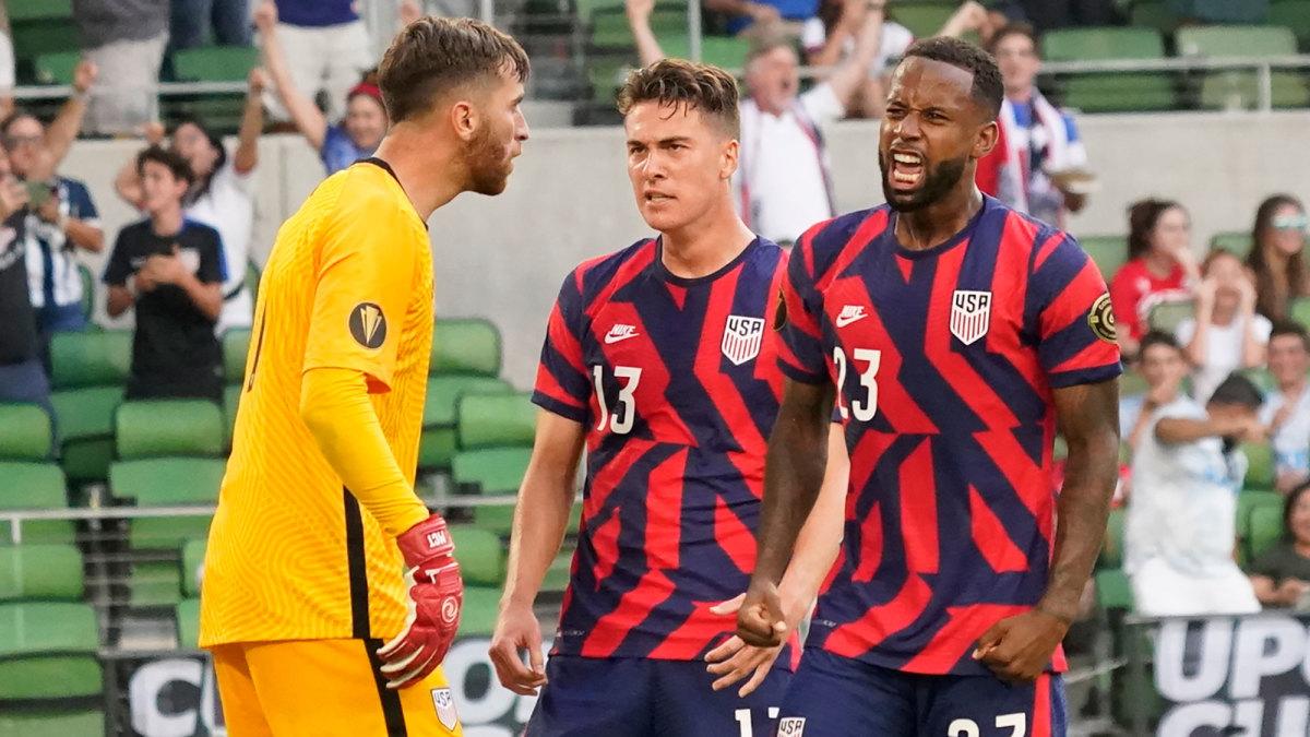 USA's Kellyn Acosta, Matt Turner and Matthew Hoppe celebrate Qatar's penalty kick miss