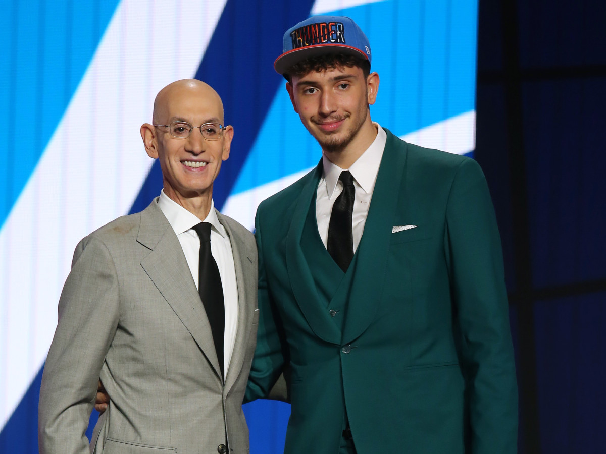 Alperen Sengun (Besiktas, Turkey) poses with NBA commissioner Adam Silver after being selected as the number sixteen overall pick by the Oklahoma City Thunder in the first round of the 2021 NBA Draft