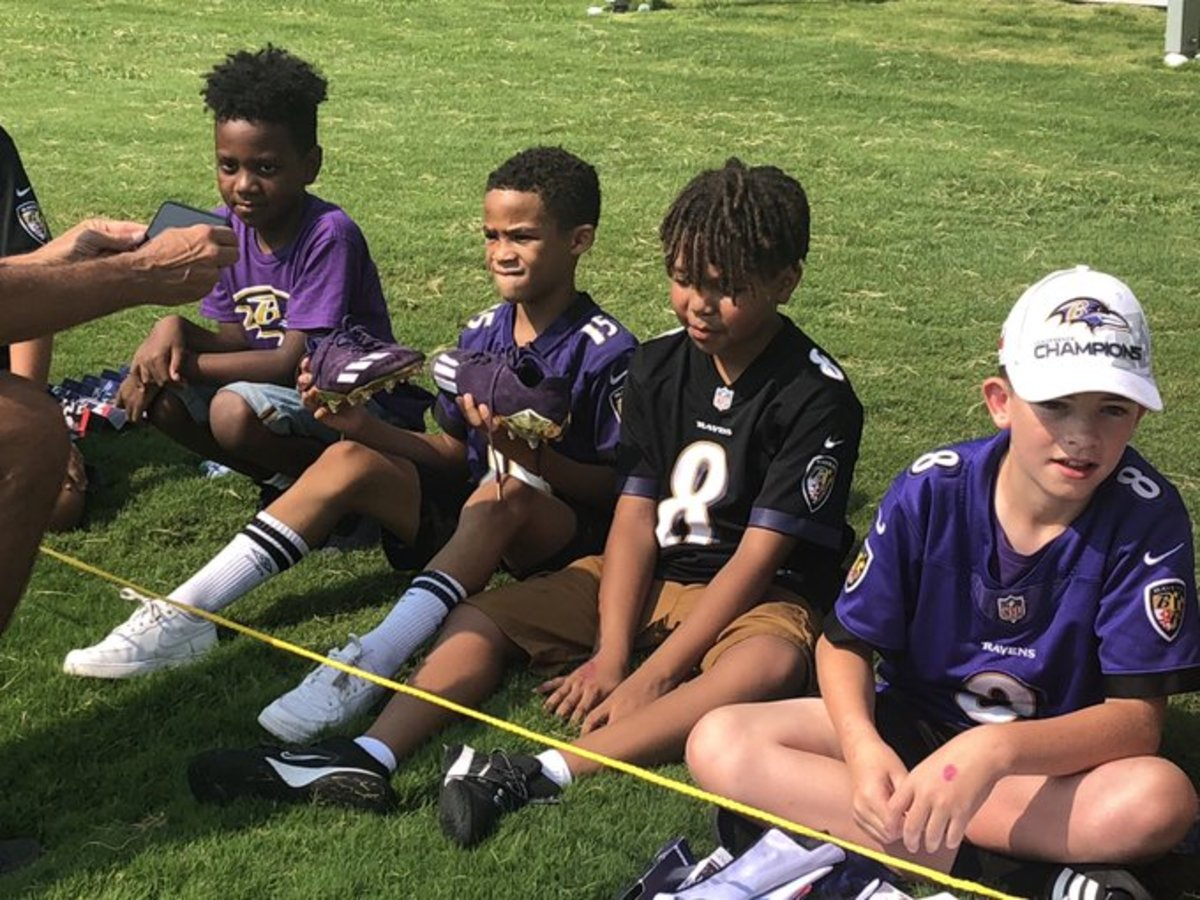 A young fan gets Sammy Watkins' Adidas cleats.