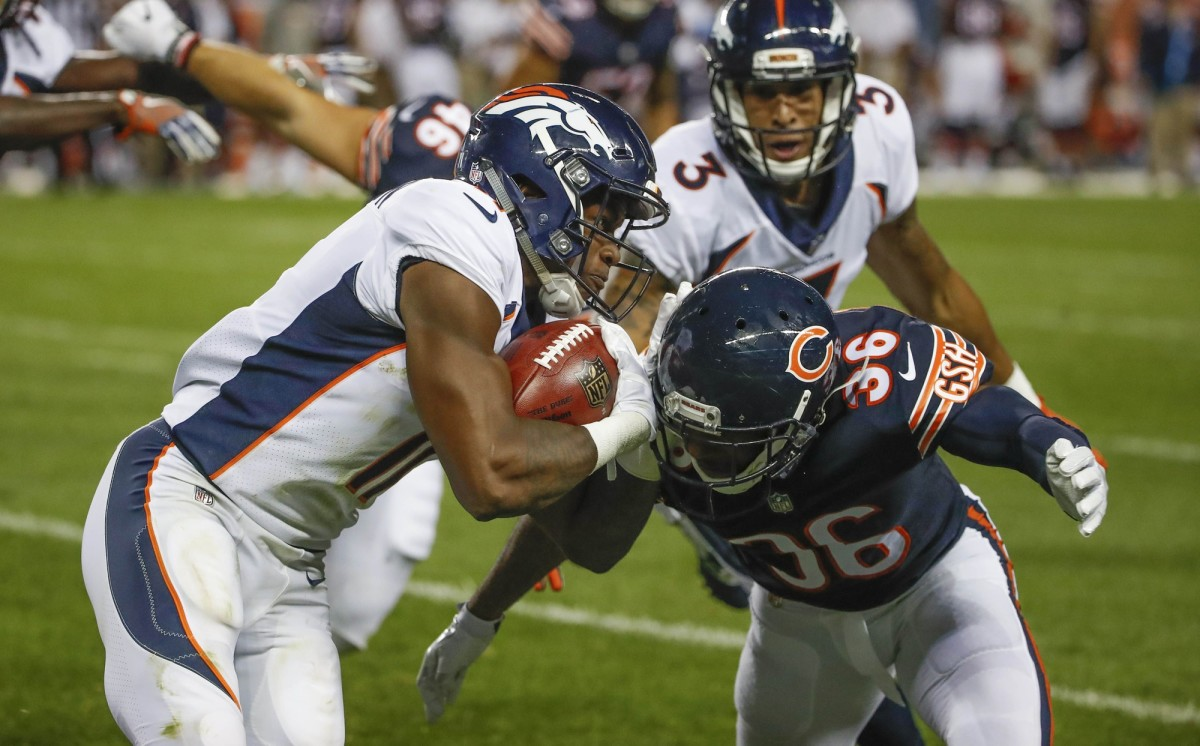 Denver Broncos wide receiver Carlos Henderson (11) is defended by Chicago Bears free safety DeAndre Houston-Carson (36) during the second half at Soldier Field.