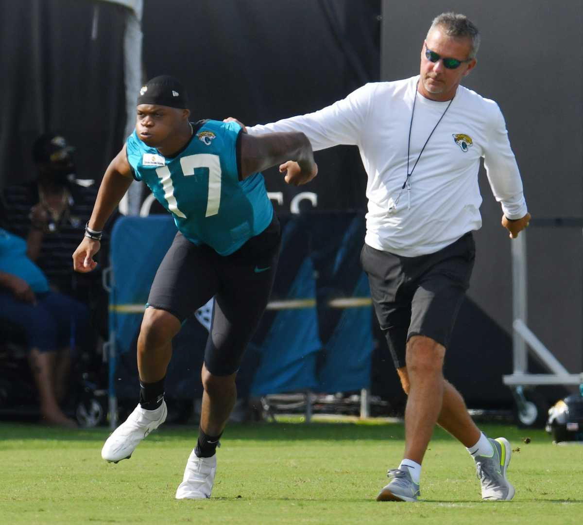 Meyer walks DJ Chark through a drill before practice.[Bob Self/Florida Times-Union]