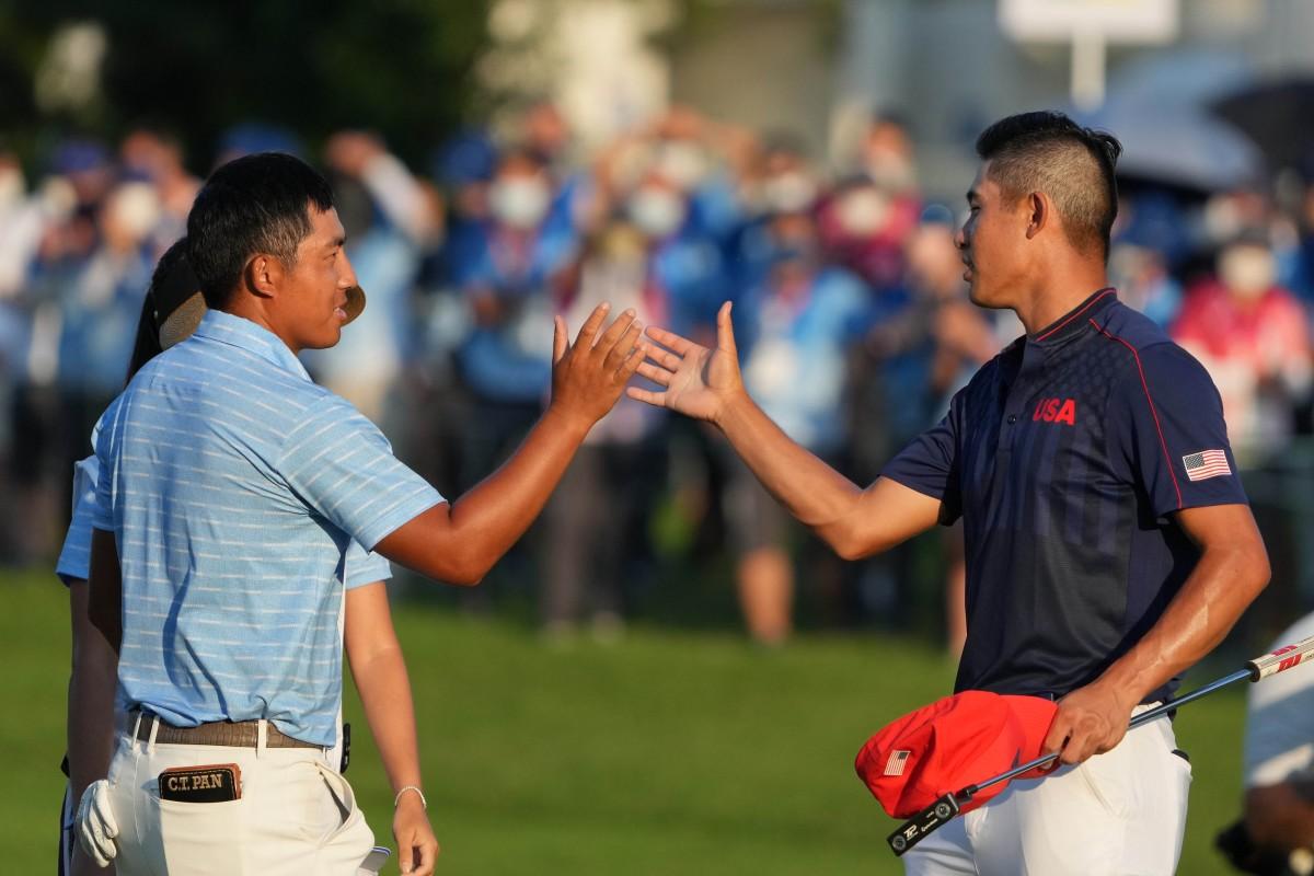 Collin Morikawa (right) congratulates C.T. Pan. Photo by Kyle Terada, USA Today.