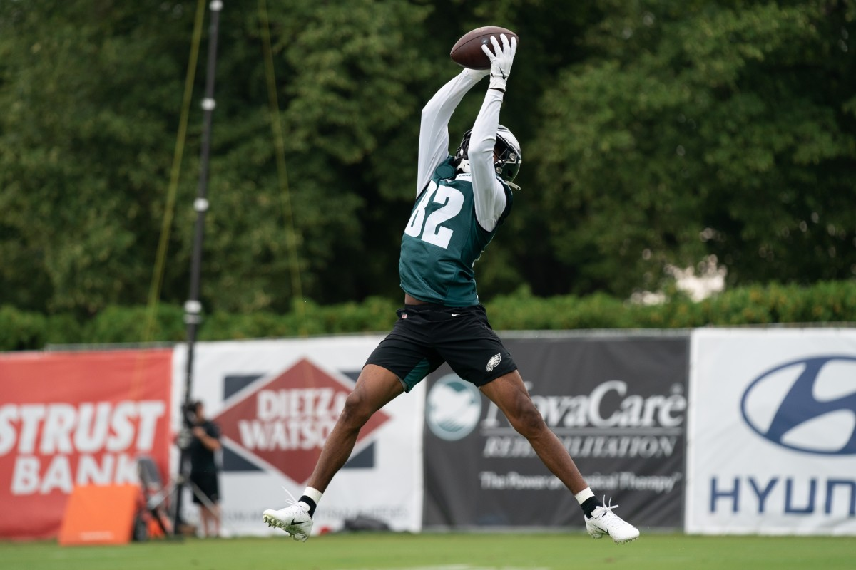 John Hightower reaches up to make a catch at Eagles camp