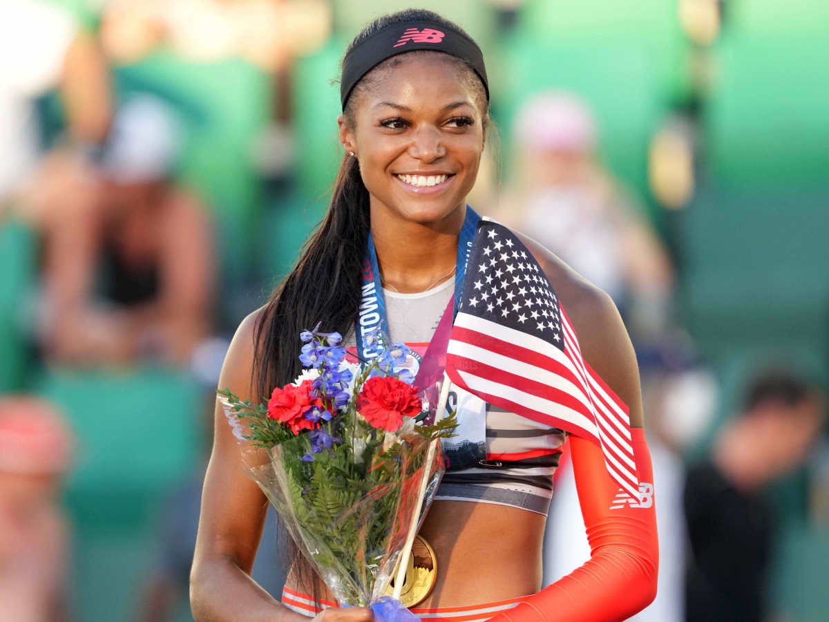 Gabby Tnomas aka Gabrielle Thomas poses with gold medal after winning the women's 200m in a meet-record 21.61 during the US Olympic Team Trials at Hayward Field.