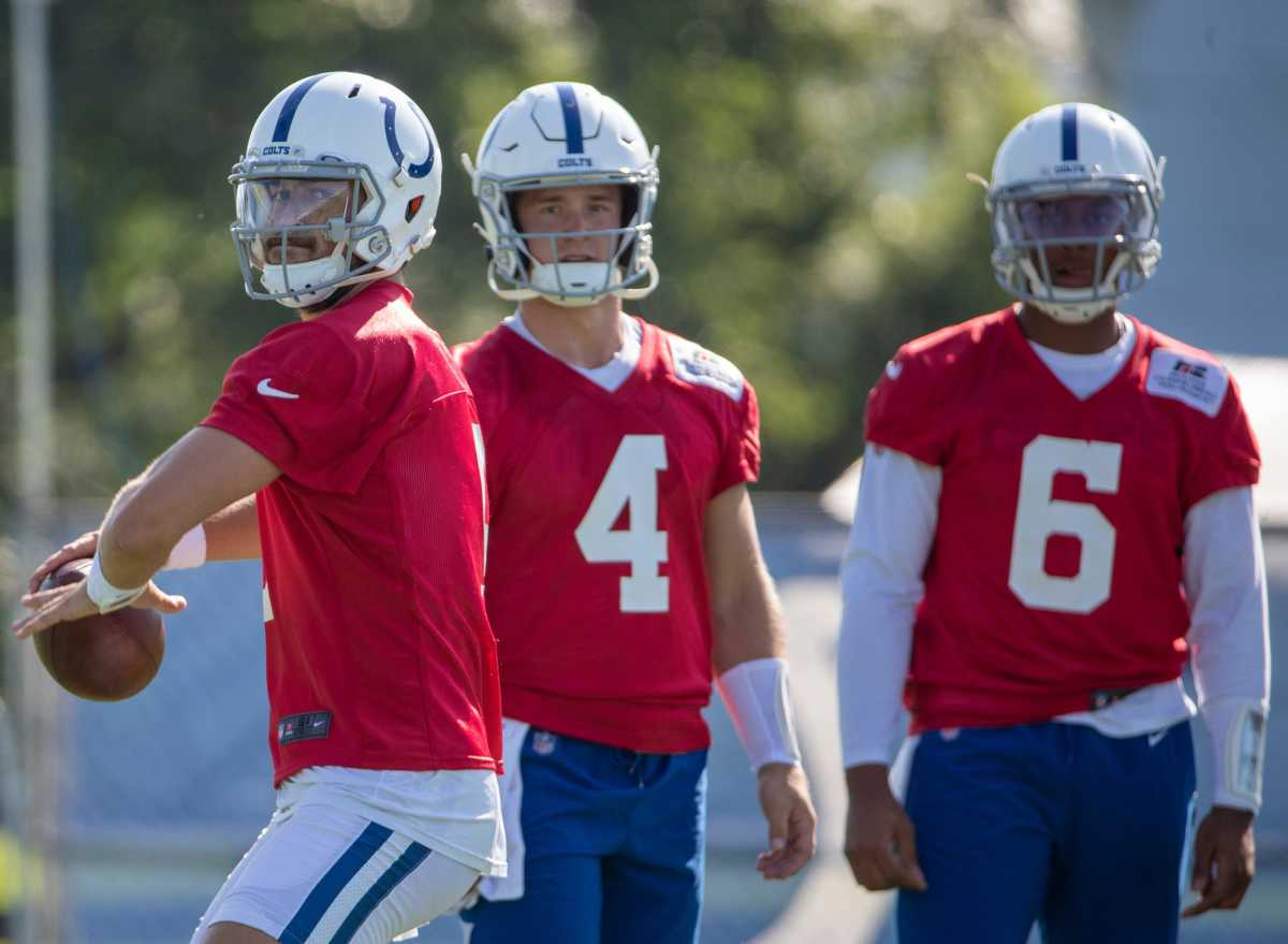Indianapolis Colts quarterback Jacob Eason (9), with Sam Ehlinger (4), and Jalen Morton, throws at Grand Park in Westfield on Monday, August 2, 2021, on the second week of workouts of this summer's Colts training camp. Head Coach Frank Reich reappeared at practice after being away for ten days after a COVID-19 positive test. Colts Get Their Coach Back On Week Two Of Colts Camp