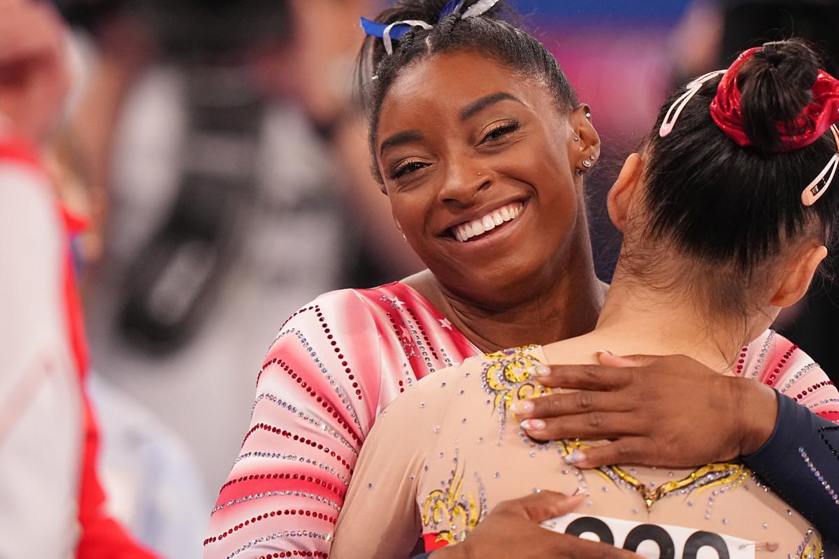 Simone Biles hugging a competitor