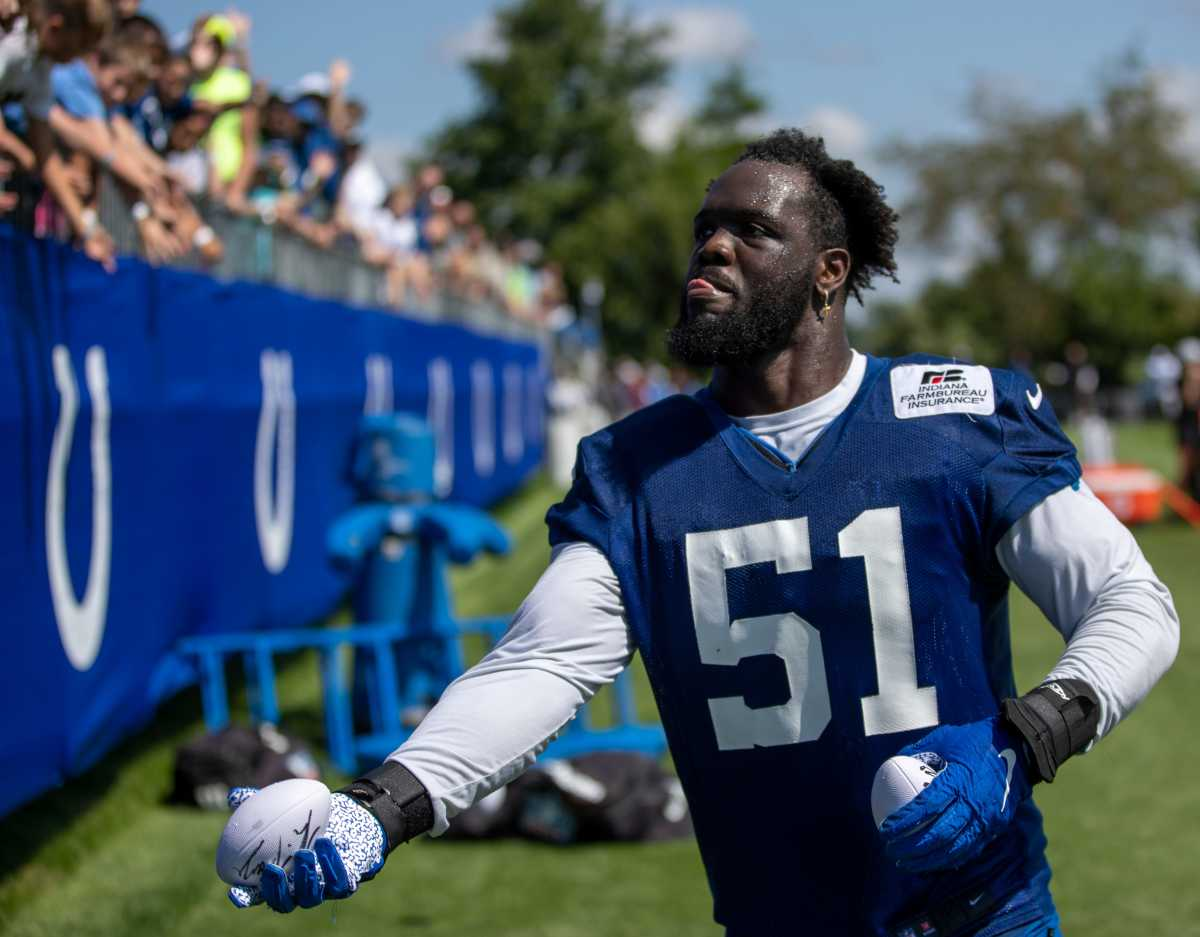 Indianapolis Colts defensive end Kwity Paye (51) tosses a souvenir ball to a fan at Grand Park in Westfield on Monday, August 2, 2021, on the second week of workouts of this summer's Colts training camp. Head Coach Frank Reich reappeared at practice after being away for ten days after a COVID-19 positive test. Colts Get Their Coach Back On Week Two Of Colts Camp