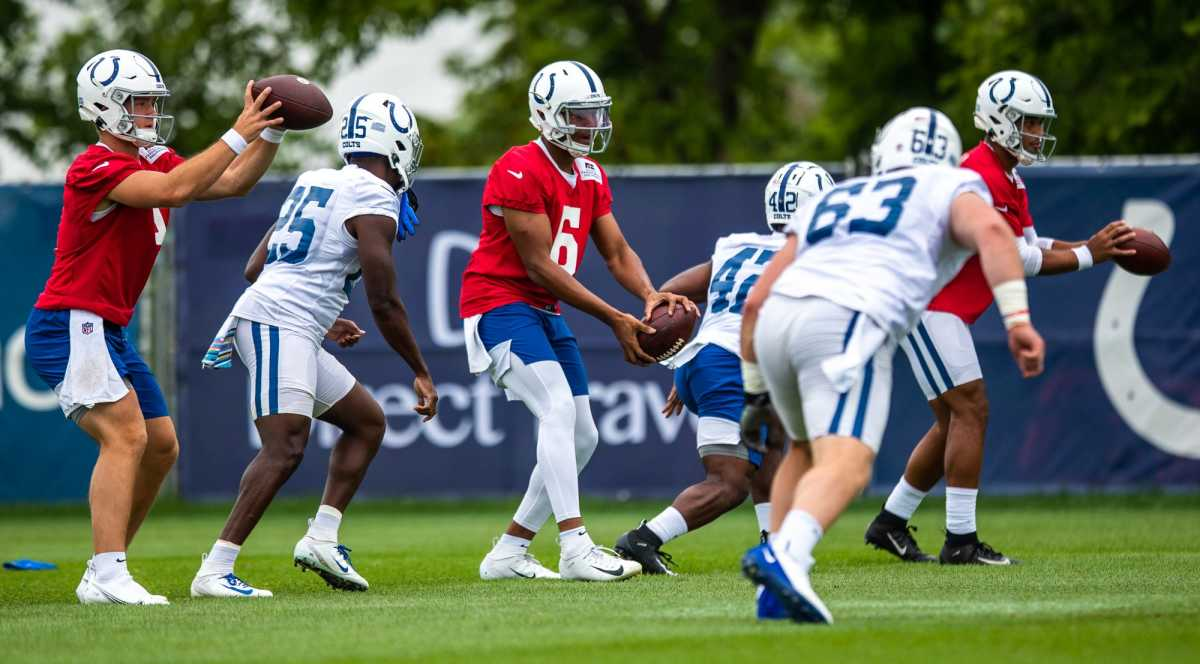 Indianapolis Colts quarterbacks and running backs run through drills during practice Saturday, July 31, 2021.