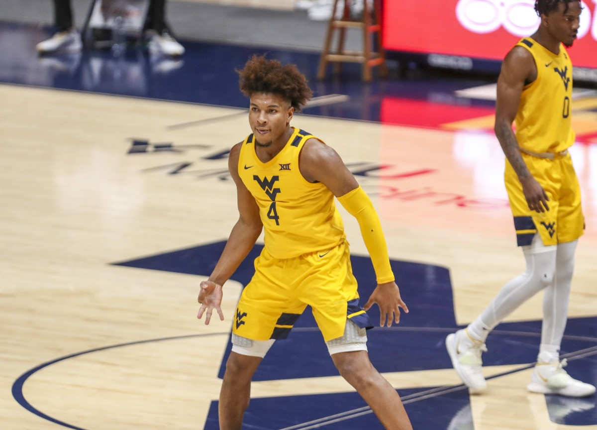 Mar 2, 2021; Morgantown, West Virginia, USA; West Virginia Mountaineers guard Miles McBride (4) celebrates after a made three-pointer during the first half against the Baylor Bears at WVU Coliseum.