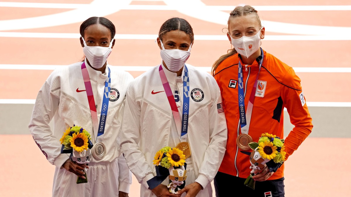 Dalilah Muhammad (USA) celebrates winning the silver medal, Sydney McLaughlin (USA) celebrates winning the gold medal and Femke Bol (NED) celebrates winning the bronze medal during the Tokyo 2020 Olympic Games