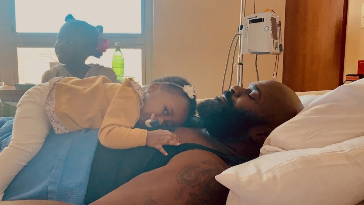 Dalton and his two daughters, Skye and Sade, together as he receives dialysis.