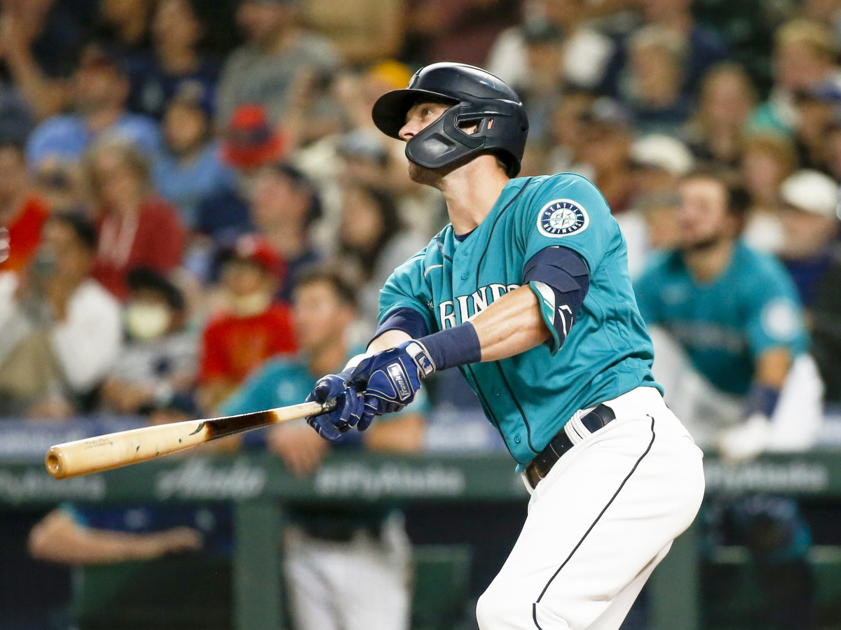 Jul 9, 2021; Seattle, Washington, USA; Seattle Mariners designated hitter Mitch Haniger (17) watches his grand slam home run against the Los Angeles Angels during the eighth inning at T-Mobile Park.