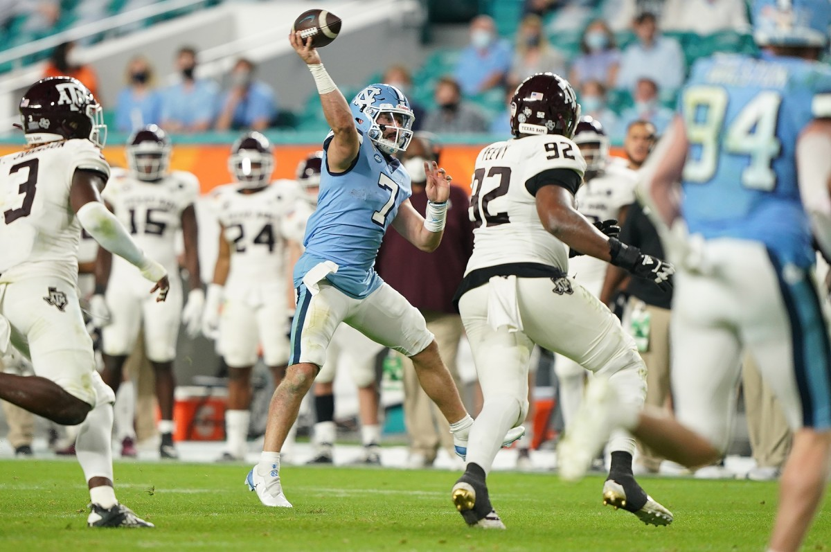Jan 2, 2021; Miami Gardens, FL, USA; North Carolina Tar Heels quarterback Sam Howell (7) gets off a pass against the Texas A&M Aggies during the second half at Hard Rock Stadium.