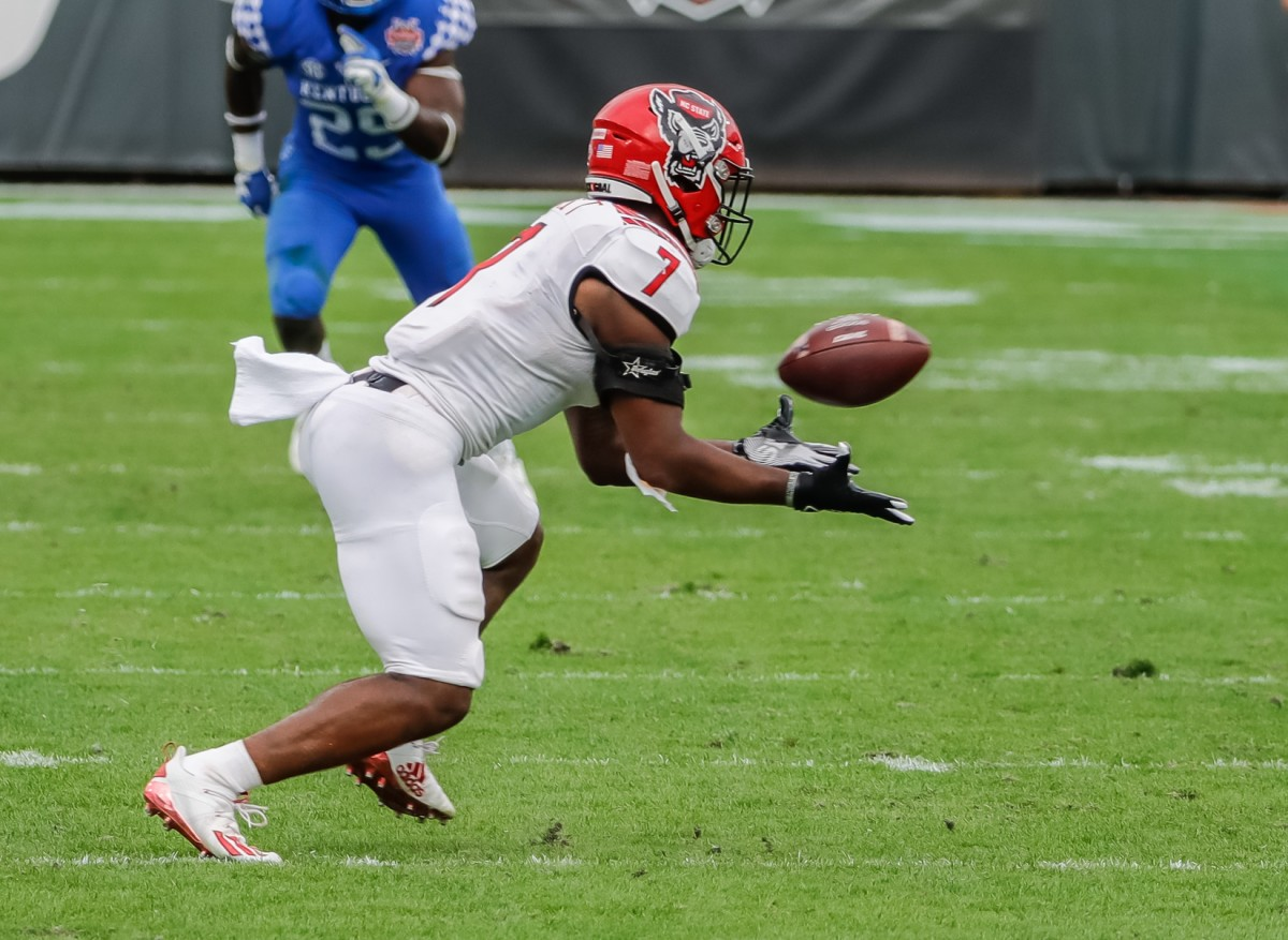 Jan 2, 2021; Jacksonville, FL, USA; North Carolina State Wolfpack running back Zonovan Knight (7) catches the ball against the Kentucky Wildcats during the second half at TIAA Bank Field.
