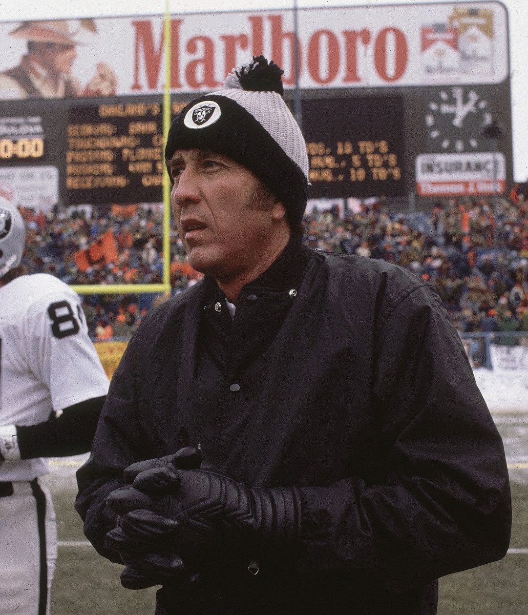 Tom Flores on the field before a playoff game in Cleveland after the 1980 season