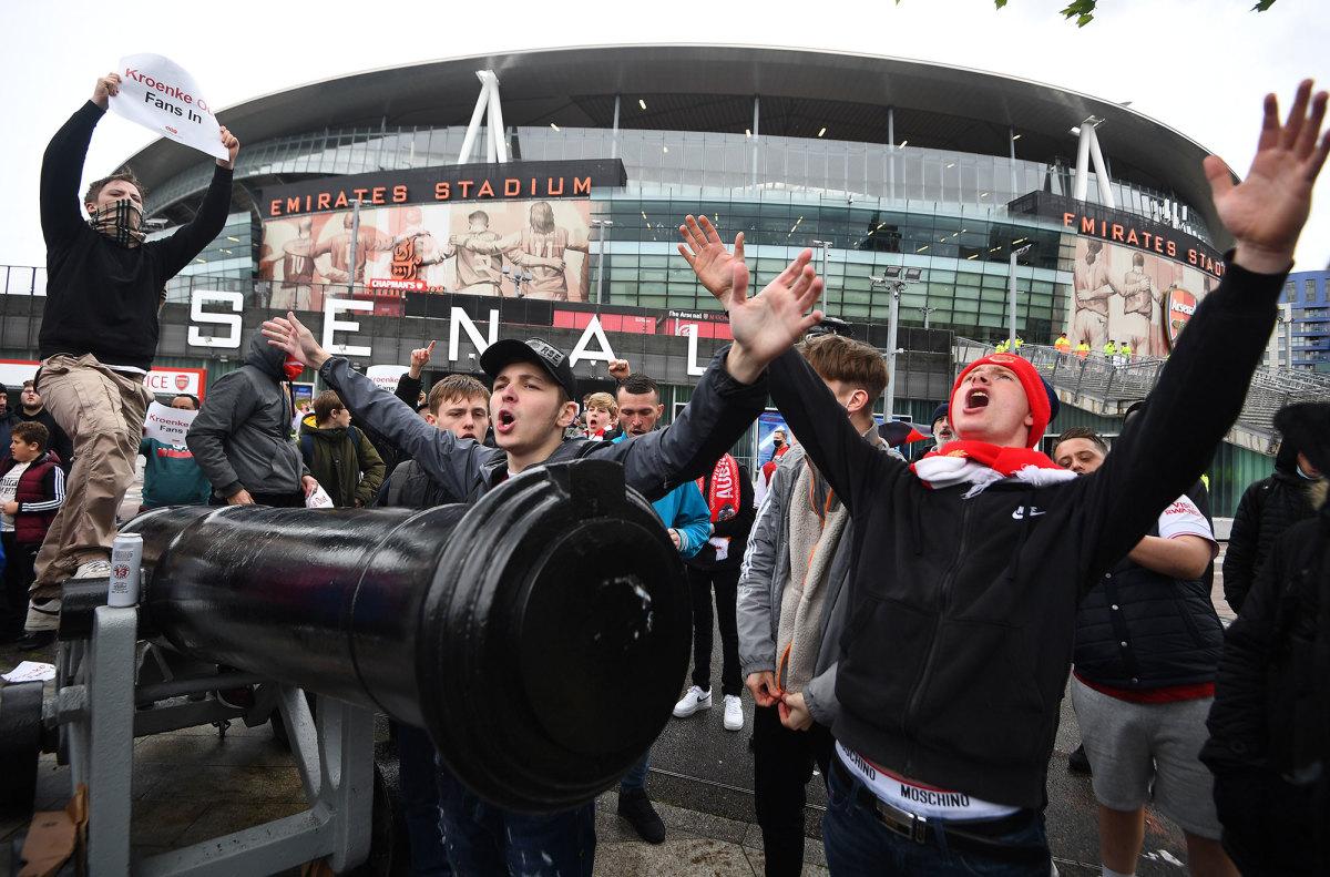 Arsenal fans outside the Emirates Stadium protest owner Stan Kroenke