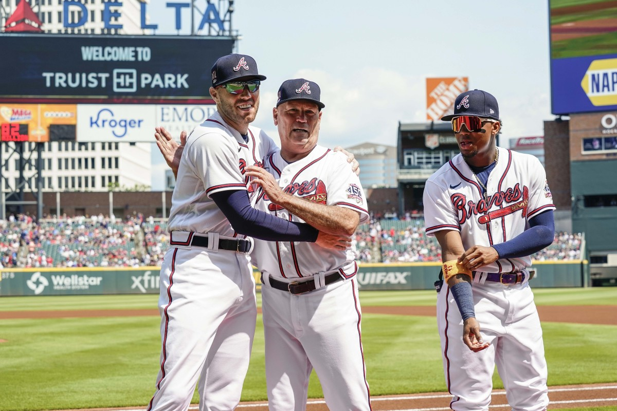 After Atlanta tabbed Snitker as interim manager in 2016, Freeman (left) pushed for his full-time hire.