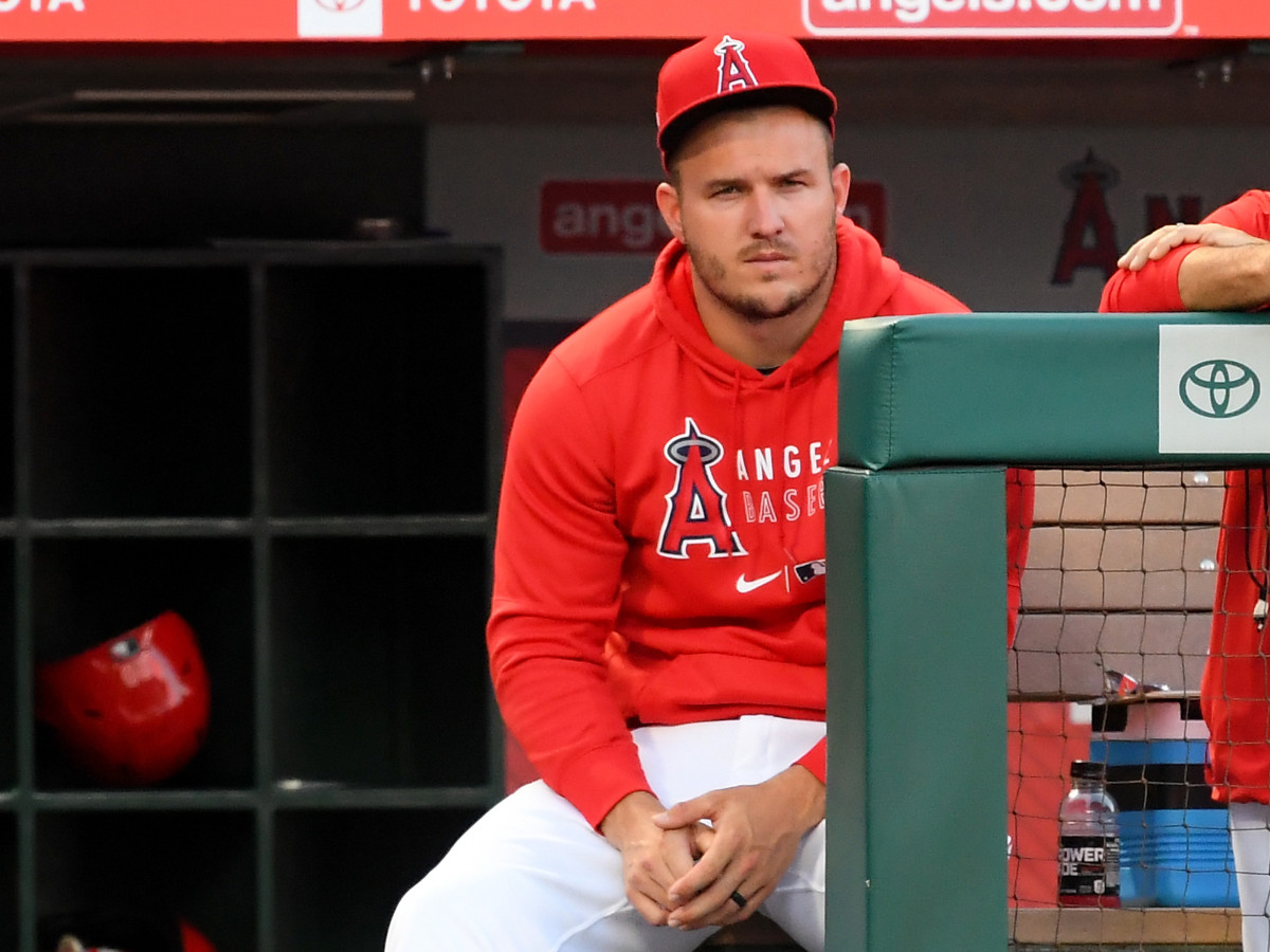 Mike Trout looks on from the dugout