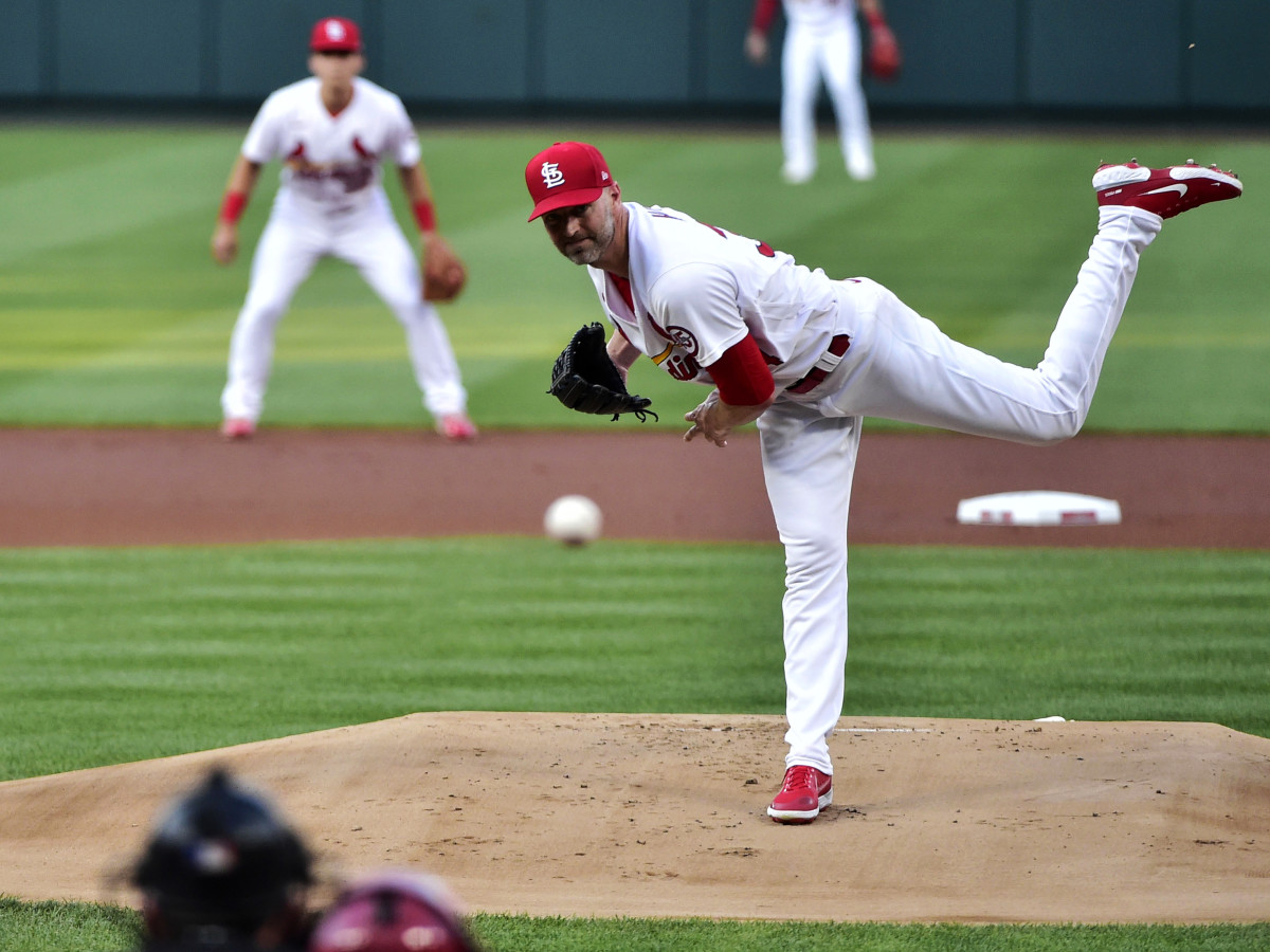Aug 4, 2021; St. Louis, Missouri, USA;  St. Louis Cardinals starting pitcher J.A. Happ (34) pitches to Atlanta Braves right fielder Jorge Soler (12) during the first inning at Busch Stadium.