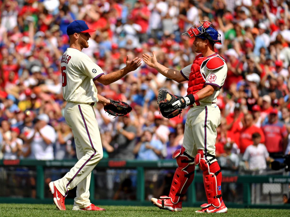 Aug 8, 2021; Philadelphia, Pennsylvania, USA; Philadelphia Phillies starting pitcher Zack Wheeler (45) and catcher J.T. Realmuto (10) celebrate win against the New York Mets at Citizens Bank Park.