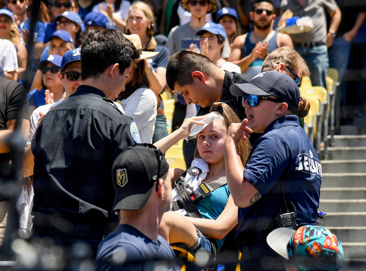Every year, fans are forced to make trips to the hospital after being injured by a foul ball; this fan was taken out of Dodger Stadium on a stretcher in 2019.
