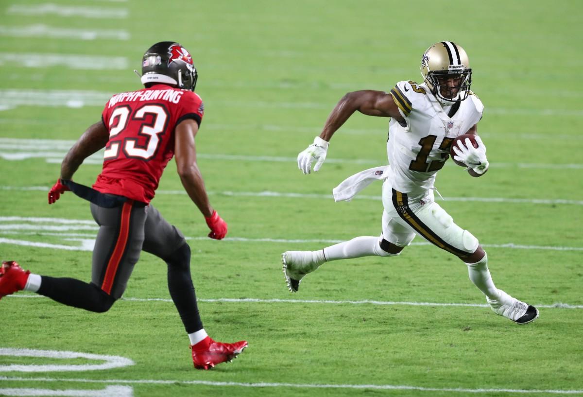 New Orleans Saints receiver Michael Thomas (13) runs against Tampa Bay cornerback Sean Murphy-Bunting (23). Mandatory Credit: Kim Klement-USA TODAY