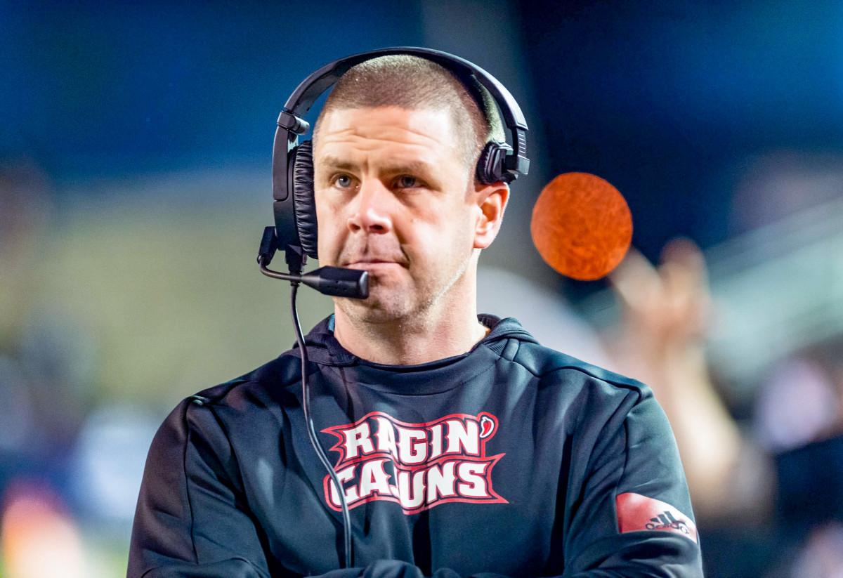 Louisiana coach Billy Napier looks on
