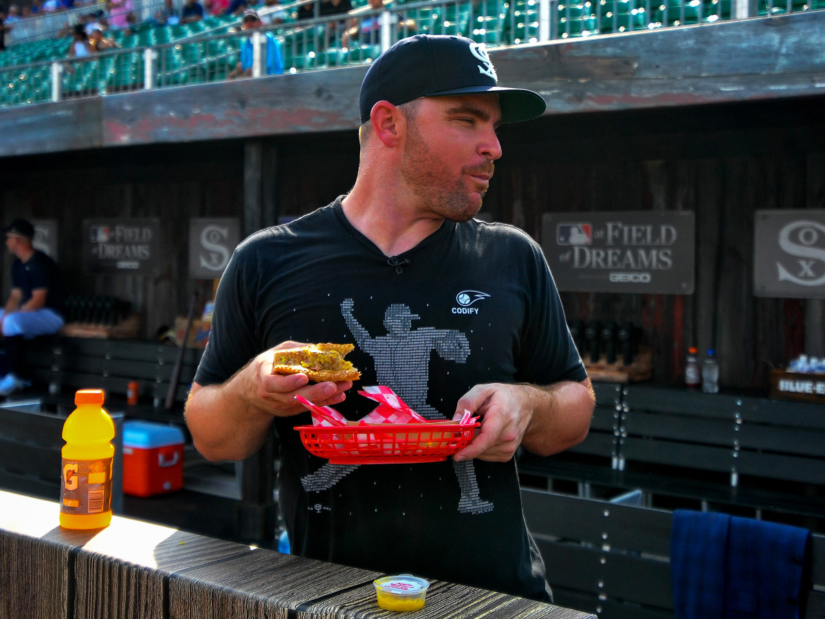 Aug 12, 2021; Dyersville, Iowa, USA; Chicago White Sox relief pitcher Liam Hendriks (31) takes in a meal before the game between the Chicago White Sox and the New York Yankees at Field of Dreams.