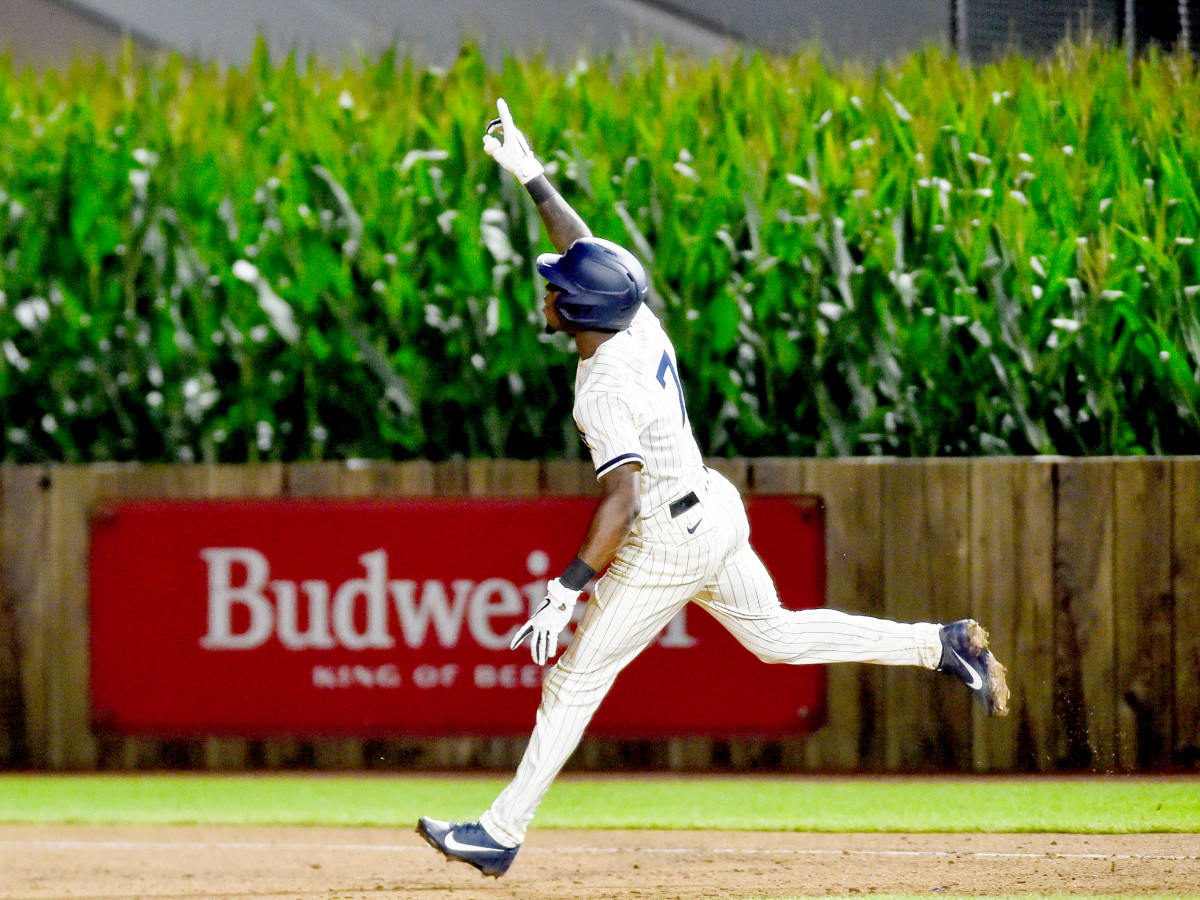 Aug 12, 2021; Dyersville, Iowa, USA; Chicago White Sox shortstop Tim Anderson (7) reacts after hitting a two-run home run in the ninth inning to defeat the New York Yankees at Field of Dreams.