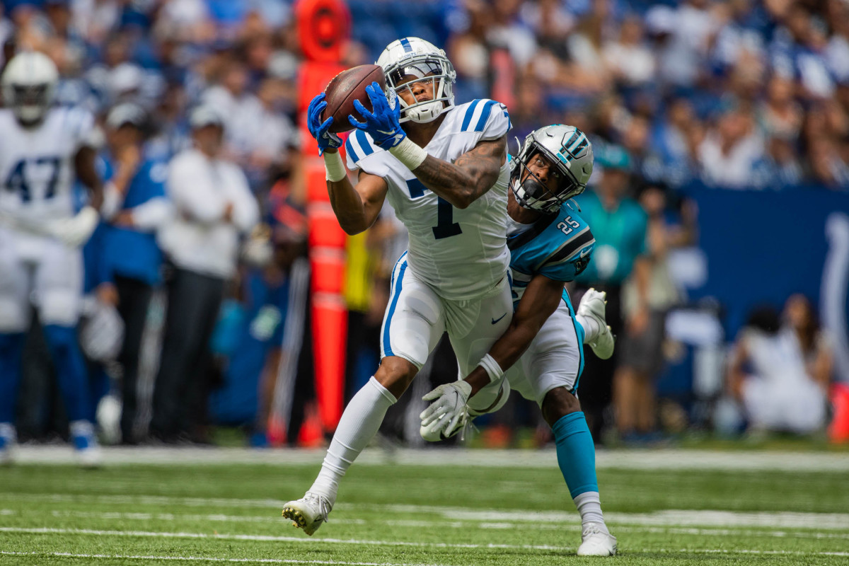 Aug 15, 2021; Indianapolis, Indiana, USA; Indianapolis Colts wide receiver Tarik Black (7) dives and catches the ball while Carolina Panthers cornerback Troy Pride (25) defends in the second half at Lucas Oil Stadium.