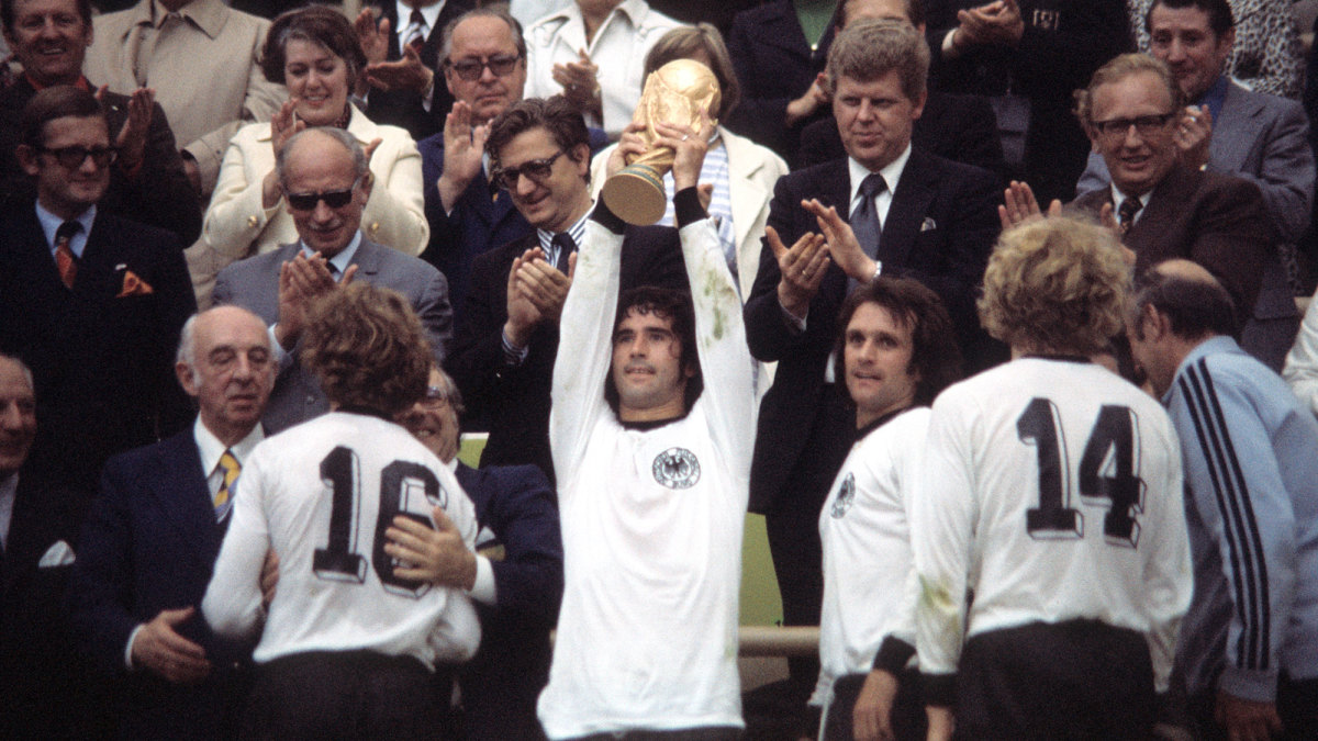 Gerd Muller lifts the World Cup trophy in 1974