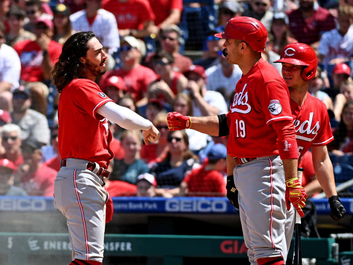 Aug 15, 2021; Philadelphia, Pennsylvania, USA; Cincinnati Reds third baseman Jonathan India (left) and first baseman Joey Votto (19) celebrate after India scored a run against the Philadelphia Phillies during the third inning at Citizens Bank Park.