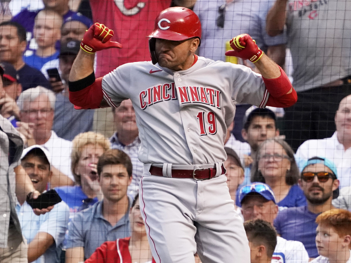 Jul 28, 2021; Chicago, Illinois, USA; Cincinnati Reds first baseman Joey Votto (19) gestures as he crosses home plate after hitting a home run against the Chicago Cubs during the second inning at Wrigley Field.