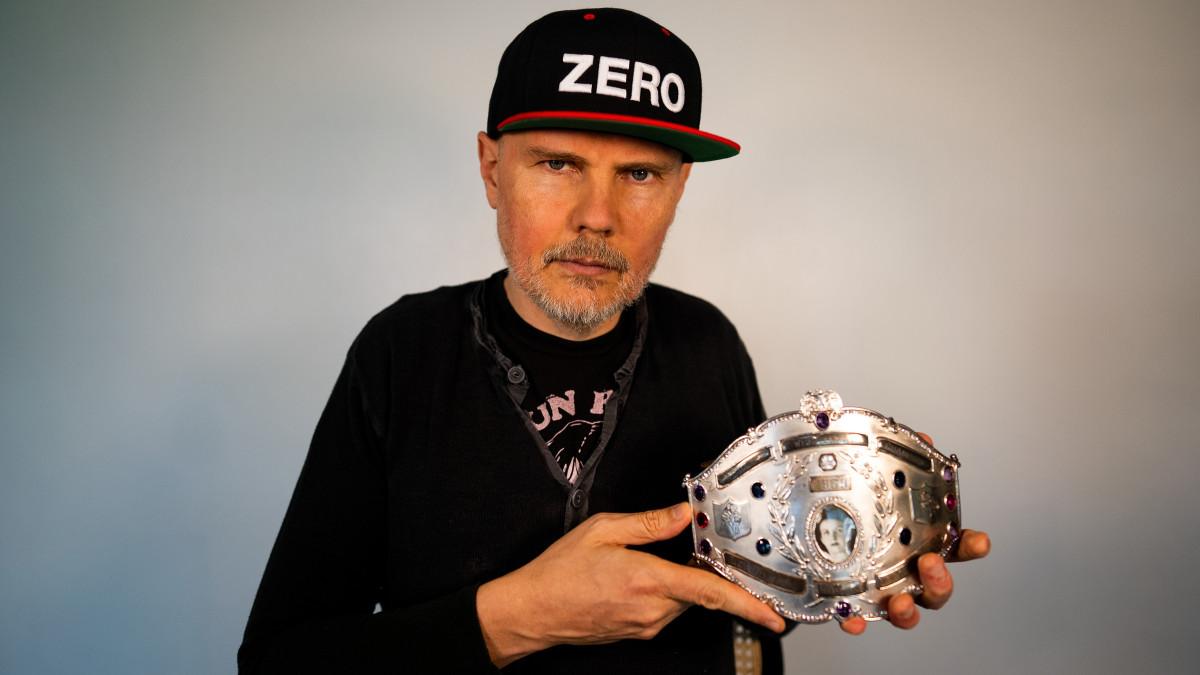 Billy Corgan holding Mildred Burke's title belt